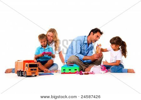 couple playing with children