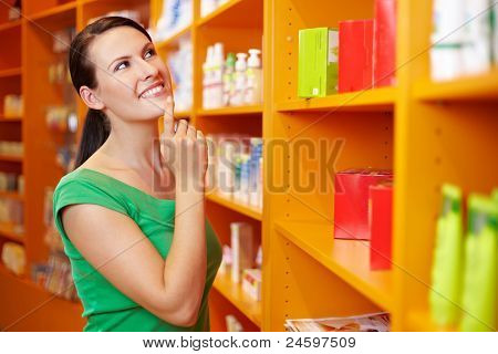 Content Woman Shopping In Pharmacy