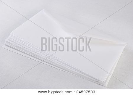 Stack Of Envelopes/letters On White Background. Not Isolated.