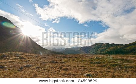 Rising Sun On A Glen Next To Fort William, Scotland
