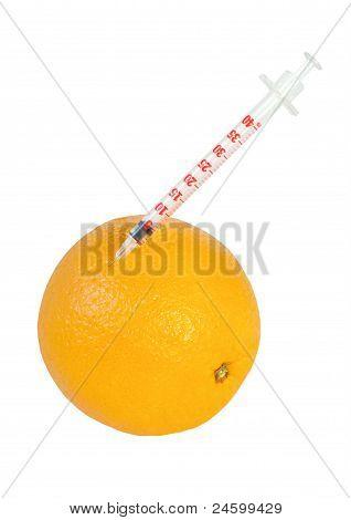 Syringe In Orange Isolated On White
