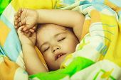 Small Baby Dreaming. Sleepy Baby In Colorful Blanket. Child Sleep In Bed. Trust And Tenderness. Chil poster