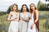 Three Beautiful Cheerful Hippie Girls, Best Friends, The Outdoors, Trendy Hairstyles, Feathers In He poster