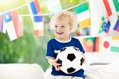 Child Watching Football Game On Tv. Little Boy In Brazil Tricot Watching Soccer Game During Champion poster