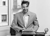 Man With Happy Face Types Story Or Business Report. Writer Or Businessman Wearing Grey Suit. Young A poster
