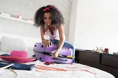 Worried Young Black Woman Packing Bags For Holiday. Girl Trying To Close Full Suitcase For Vacation, poster