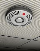 picture of smoke detector  - Illustration of a smoke and fire detector in gray at a gray ceiling - JPG