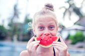 A Girl Eats A Cold Watermelon Outdoor In A Very Hot Day.concept Photo Of Hot Weather, Heat Wave, Sum poster
