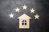 Wooden House And Five Stars On A Gray Background. Rating Of Houses And Private Property. Buying And  poster