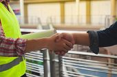 Engineers Celebrating Success, Clapping With Hands.teamwork Conceptual Image.engineers Shaking Hand poster