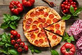 Pepperoni Pizza, Tomatoes And Basil. Tasty Pepperoni Pizza On Rustic Wooden Background. Overhead Vie poster