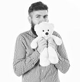 Kindness, Care And Tenderness Concept. Guy With Beard Hugs Soft Toy With Tenderness. Hipster Cares A poster