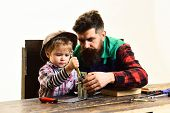 Repair, Assistance, Fatherhood Concept - Son&father Repairing Together. Boy Connects Metal Plates Pa poster