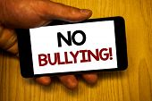 Handwriting Textss Writing No Bullying Motivational Call. Concept Meaning Forbidden Abuse Harassment poster