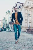 Full Size Fullbody Portrait Of Stunning Cool Macho In Fashionable Outfit Going For Work Holding Hand poster