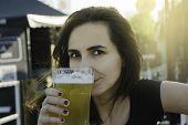 Beautiful Girl Having A Beer. Girl Having A Beer In Summertime. Drinking Beer In The Pub. Draft Beer poster