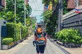 Man With Backpack Walking In The Streets Of Bangkok. Backpacker In Travel poster