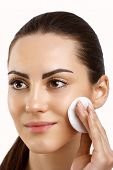 Beauty Face. Beautiful Woman With Natural Makeup.skin Care. Woman Removing Face Makeup With Cotton P poster