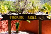 Designated Smoking Area. Smoking Area Sign On A Beach In Labadee, Haiti poster