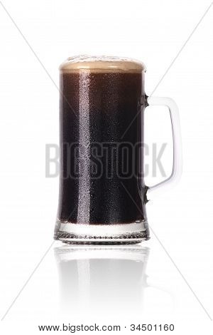 Frosty Glass Of Dark Beer With Foam And Water Drops Isolated