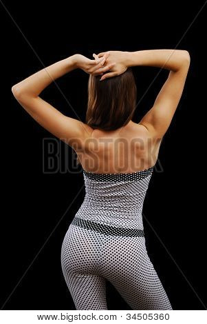 Young Woman In The Bodysuit From Back