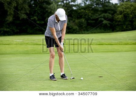 Woman Is Playing Golf On Course  Summer