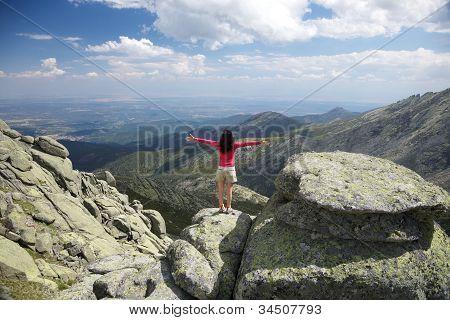 Cross Arms Woman On Sunny Rock