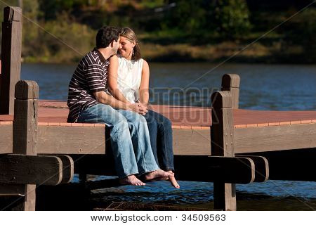 Young Couple Share Romantic Moment On Dock