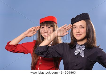 two pretty smiling young flight attendantes