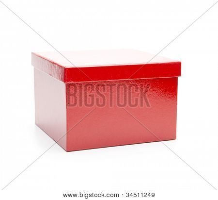 Bright red gift box, lid closed. Isolated on white.