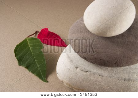 Balancing Pebbles With Leafs And Candles