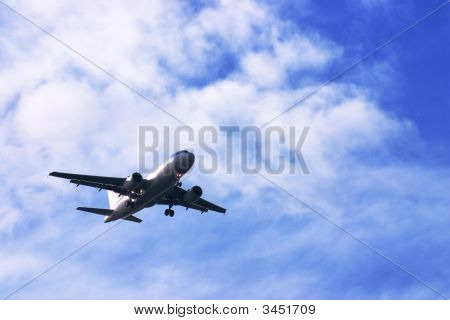 Airliner In Cloudy Sky