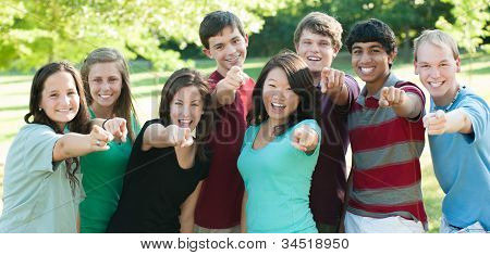 Ethnic Group Of Happy Teenage Friends Outside