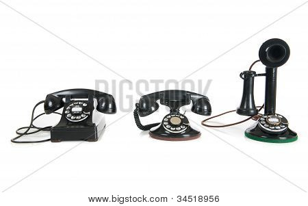 Black Antique Phones On A White Background
