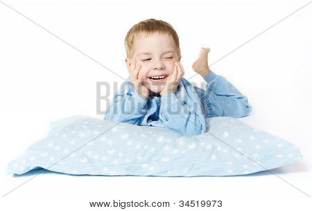 Smiling Child Lying Down With Pillow