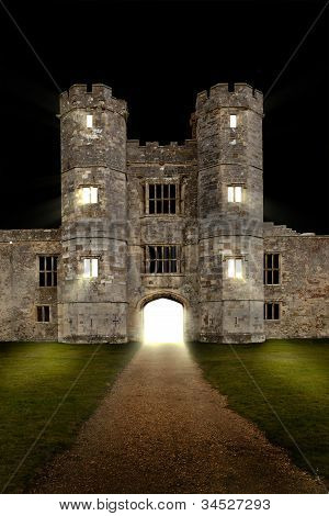 Old castle at night with lights shining through open door