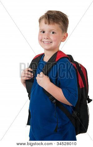 Young boy with backpack on white
