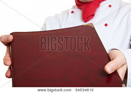 Hands of a chef cook holding menu card
