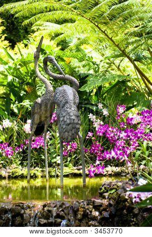 Crane Sculpture In Orchid Garden