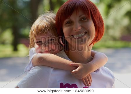 Happy Mother & Daughter On Her Her Back