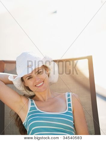 Happy Woman Laying On Sunbed