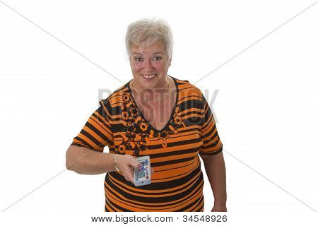 Senior Woman Zapping With Remote Control