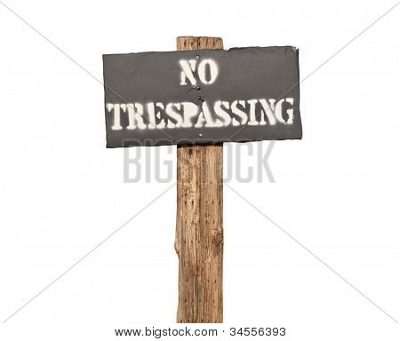 Funky stenciled no trespassing sign on wooden post.
