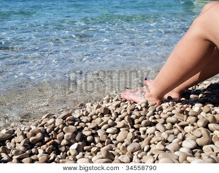 Female feet in the sea