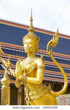 Golden Angel with Pagoda in Emerald Buddha temple (Wat Pra Kaeo), Bangkok, Thailand