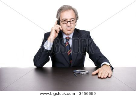 Mature Businessman On The Phone
