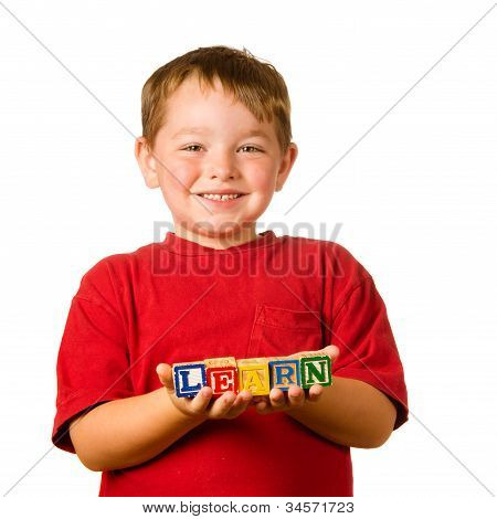 Preschool education concept with child holding blocks that spell out