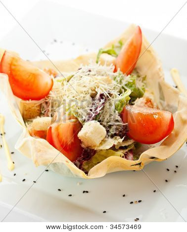 Seafood Caesar Salad with Shrimps, Salad Leaf, Croutons, Tomato and Parmesan Cheese. Garnished on Baked Pastry