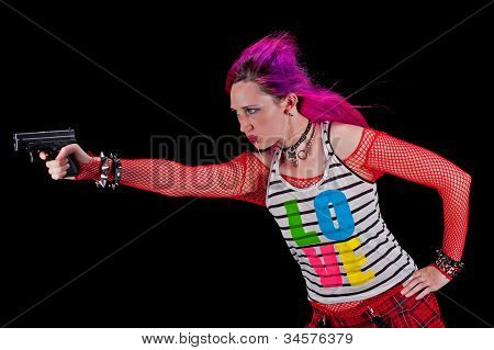Woman In punk clothing aiming a gun