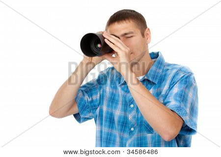 Handsome Young Man Holding Camera Lens Like It Was Spyglass On White Background